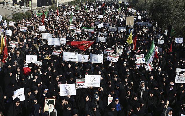 Iranian protesters chant slogans at a rally in Tehran, Iran, December 30, 2017.  (AP Photo/Ebrahim Noroozi)