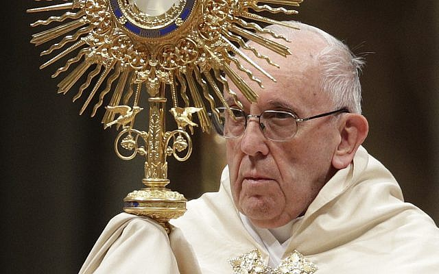 Pope Francis holds a monstrance, as he celebrates a New Year's Eve vespers Mass in St. Peter's Basilica at the Vatican, Sunday, December 31, 2017. (AP Photo/Andrew Medichini)
