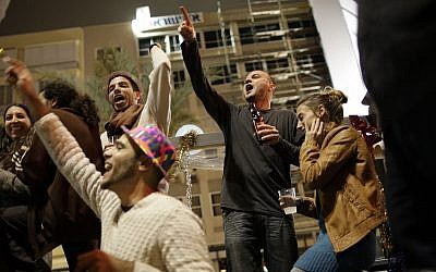 Israelis cheer at a New Year's Eve celebration in central Tel Aviv. (AP Photo/Ariel Schalit/File)