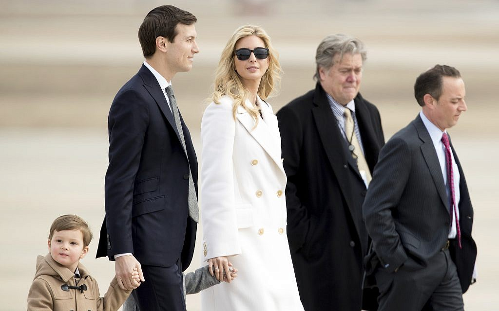 Ivanka Trump, daughter of President Donald Trump, her husband, senior adviser Jared Kushner, their two children Arabella Kushner and Joseph Kushner, Chief White House Strategist Steve Bannon, second from right, and Chief of Staff Reince Priebus, right, walk to Air Force One at Andrews Air Force Base in Md., Friday, Feb. 17, 2017. (AP Photo/Andrew Harnik)