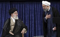 Supreme Leader Ayatollah Ali Khamenei, left, and President Hassan Rouhani greet at the official endorsement ceremony of President Rouhani in Tehran, Iran, August. 3, 2017. (Office of the Iranian Supreme Leader via AP)