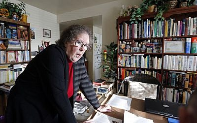 In this Monday, Nov. 6, 2017, photo, Helen Radkey, a researcher of the Mormon church's massive genealogical database, is at her home in Holladay, Utah. (AP Photo/Rick Bowmer)