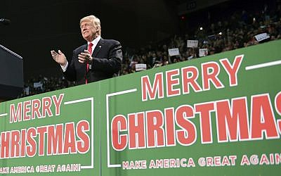 In this December 8, 2017, file photo, US President Donald Trump takes to the stage at a campaign-style rally at the Pensacola Bay Center, in Pensacola, Florida.  (AP Photo/Susan Walsh, File)