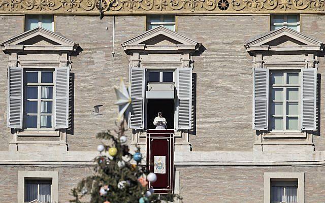 Pope focuses on the world's trouble spots in Christmas message