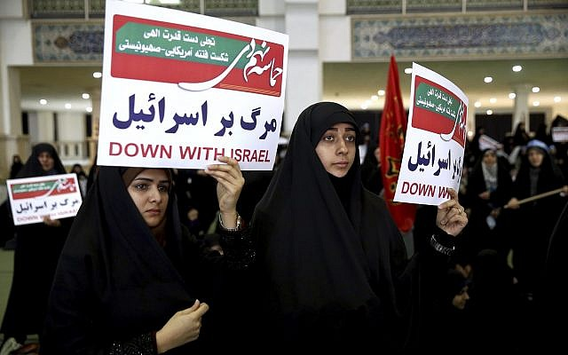 Iranian pro-regime protesters hold anti-Israeli placards at a rally in Tehran, Iran, Saturday, December 30, 2017 (AP Photo/Ebrahim Noroozi)