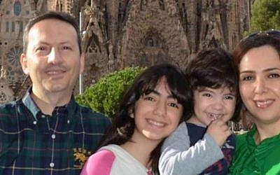 Ahmadreza Djalali, left, and his family. (Screen capture via YouTube/Amnesty International)