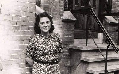Alice Cohn poses in front of the building in which she hid from the Nazis, in Utrecht, the Netherlands. The photo was taken after the liberation of Europe in 1945. (Courtesy: National Holocaust Museum)