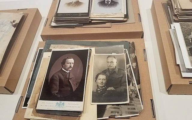 At the National Holocaust Museum in Amsterdam, the Netherlands, an exhibit on the creation of Nazi-era forgeries includes headshots of Dutch men and women  as used by the national population registry, December 2017. (Matt Lebovic/The Times of Israel)