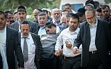 Thousands mourning the deceased members of the Azan family at a funeral in Holon, Israel, December 20, 2017. (Flash90 via JTA)