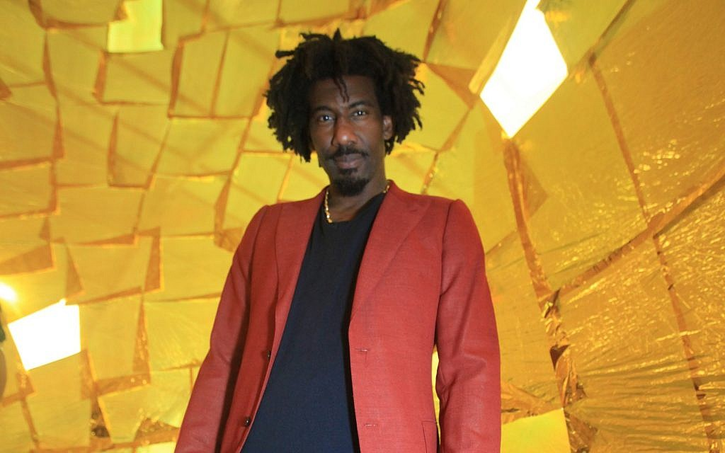 Amar'e Stoudemire at SCOPE Miami in December 2017, where a painting he commissioned on the destruction of the Second Temple is exhibited. (SCOPE Art Show)