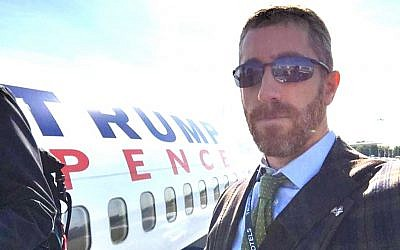 Joel Pollak in front of the Trump/Pence presidential campaign plane in 2016. (Courtesy)