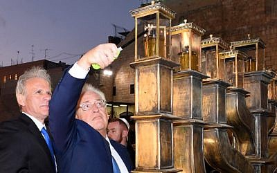 US Ambassador to Israel David Friedman lights the menorah at the Western Wall in Jerusalem, December 13, 2017. (Courtesy)