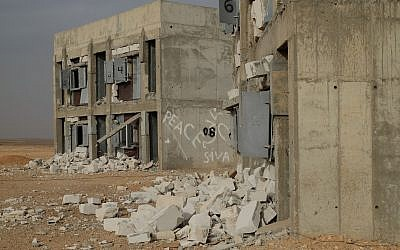 The remains of blast tests on building materials in the army's Sayarim Base in the Arava desert in southern Israel on December 27, 2017. (Judah Ari Gross/Times of Israel)