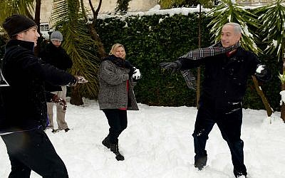 Prime Minister Benjamin Netanyahu has a snowball fight with his wife, Sara, and sons Avner and Yair at his residence in Jerusalem on January 10, 2013 (Avi Ohayon/GPO/FLASH90)