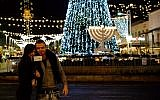 Celebrating the Holiday of Holidays, the cross-section of Hanukkah, Christmas and Id al-Adha in Haifa (Sapir Bronzberg/Flash 90)