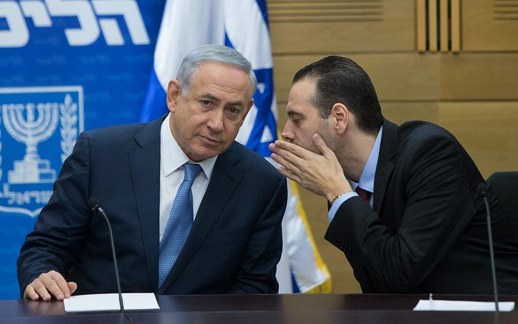 Prime Minister Benjamin Netanyahu (L) with MK Miki Zohar during a Likud faction meeting at the Knesset, December 7, 2015. (Yonatan Sindel/Flash90)