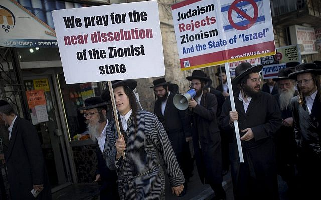 Illustrative: Ultra-Orthodox Jew, belonging to the anti-Zionist Neturei Karta group protest against the State of Israel in Jerusalem's Mea Shearim neighborhood on August 4, 2016. (Yonatan Sindel/Flash90)