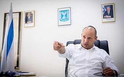 Israeli minister of Education Naftali Bennett seen during an interview, in his office at the Ministry of Education in Tel Aviv, on August 28, 2016. (Miriam Alster/FLASH90)