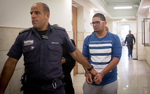 Murad Rajabi, 20-years-old from Silwan is escorted by prison guard into the courtroom at the District Court in Jerusalem on November 3, 2016 (Yonatan Sindel/Flash90)