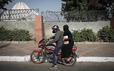 Illustrative: A woman wearing a burqa rides a motorcycle  in New Delhi, India, on December 12, 2016. (Nati Shohat/Flash90)