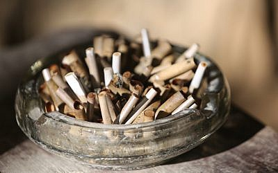 Illustrative photo of cigarettes in an ashtray (Yossi Zamir/Flash90)