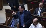 Joint (Arab) List party chairman Ayman Odeh reacts during a plenum session in the assembly hall of the Israeli parliament, January 25, 2017. (Yonatan Sindel/Flash90)