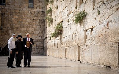 US President Donald Trump (r) with Rabbi of the Western Wall Shmuel Rabinowitz (c) at the Western Wall, in the Old City of Jerusalem on May 22, 2017. (Nati Shohat/Flash90)