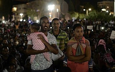 "African migrants take part in a protest in Tel Aviv on June 10, 2017, against the ""Deposit Law,"" which requires them to deposit 20 percent of their salary in a fund which they can only take back after they leave the country . (Tomer Neuberg/Flash90)"