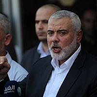 Hamas chief Ismail Haniyeh speaks to the press at the Rafah Border Crossing with Egypt in the southern Gaza Strip on September 19, 2017. (Abed Rahim Khatib/Flash90)