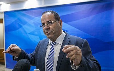 Communications Minister Ayoub Kara speaks to reporters prior to the weekly cabinet meeting at the Prime Minister's office in Jerusalem on November 12, 2017. (Olivier Fitoussi/Pool/Flash90)