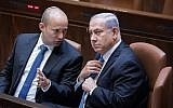 Prime Minister Benjamin Netanyahu (right) speaks with Education Minister Naftali Bennett on November 13, 2017, in the Knesset. (Yonatan Sindel/Flash90)