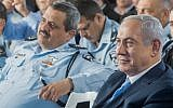 Prime Minister Benjamin Netanyahu, right, and Chief of Police Roni Alsheich at an inauguration ceremony marking the opening of a new police station in the northern Arab Israeli town of Jisr az-Zarqa November 21, 2017. (Basel Awidat/Flash90)