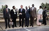 Knesset Chairman, Yuli Edelstein (3l) with seven parliamentary speakers from African countries during a visit at the solar panels on the Knesset rooftop in Jerusalem, December 5, 2017. (Issac Harari/Flash90)