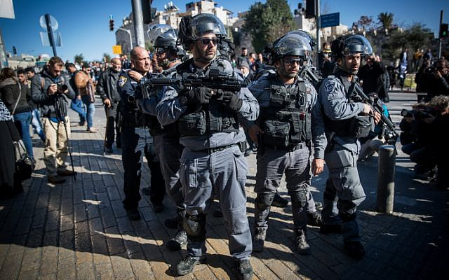 Israeli Police officers stand guard during a protest at Damascus Gate in the Old City of Jerusalem on December 8, 2017. (Yonatan Sindel/Flash90)