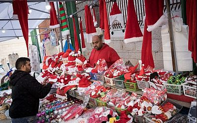 Christian Arabs sell Santa Claus hats and dolls in Nazareth ahead of Christmas on December 9, 2017. (Nati Shohat/Flash90)
