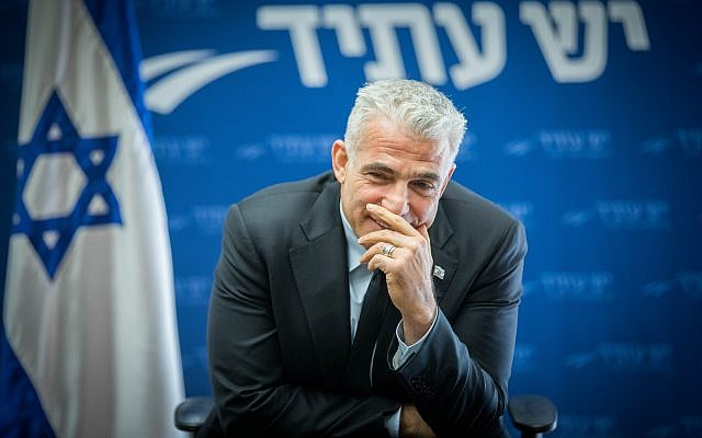 Yesh Atid party leader Yair Lapid leads a Yesh Atid faction meeting at the Knesset, December 11, 2017. (Yonatan Sindel/Flash90)