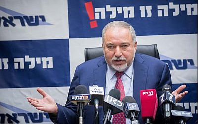 Defense Minister Avigdor Liberman heads a Yisrael Beytenu faction meeting at the Knesset on December 11, 2017. (Yonatan Sindel/Flash90)