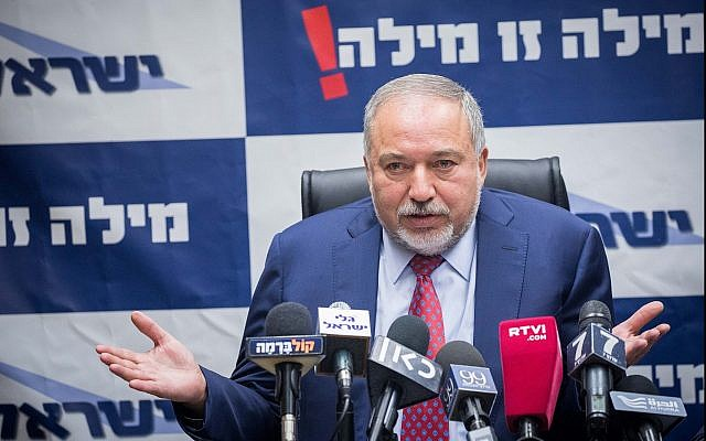 Defense Minister Avigdor Liberman heads a Yisrael Beytenu faction meeting at the Knesset on December 11, 2017. (Yonatan Sindel/Flash90)