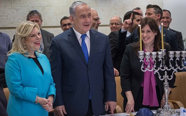 Prime Minister and Foreign Minister Benjamin Netanyahu, his wife Sara, and Deputy Foreign Minister Tzipi Hotovely, take part in Hanukkah candle lighting ceremony at the Foreign Ministry in Jerusalem, on December 12, 2017. (Hadas Parush/Flash90)