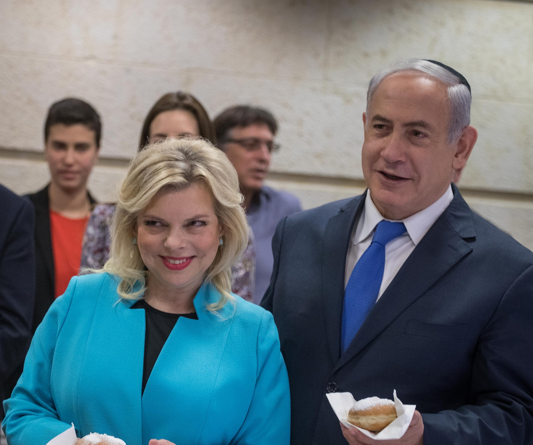 Prime Minister Benjamin Netanyahu his wife Sara take part in a menorah lighting ceremony on the first candle night of the Jewish holiday of Hanukkah at the Foreign Ministry in Jerusalem
