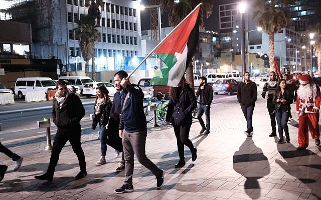 Arab Israelis take part in a protest outside the American embassy in Tel Aviv against US President Donald Trump's decision to recognize Jerusalem as Israel's capital on December 12, 2017. (Tomer Neuberg/Flash90)