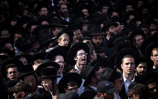 Thousands of followers of Rabbi Aharon Leib Steinman attend his funeral in the Bnei Brak, on December 12, 2017. Rabbi Aharon Leib Shteinman passed away earlier this morning at the age of 104. (Yonatan Sindel/Flash90)