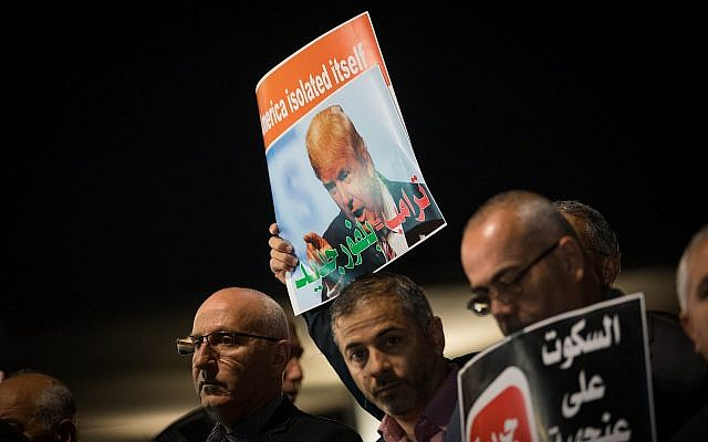 Arab Israelis take part in a protest outside the American embassy in Tel Aviv against US President Donald Trump's decision to recognize Jerusalem as Israel's capital on December 12, 2017. (Yonatan Sindel/Flash90)