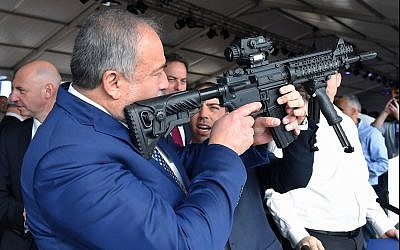 Defense Minister Avigdor Liberman visits a weapons factory in Sderot on December 14, 2017. (Ariel Hermoni/Defense Ministry/Flash90)