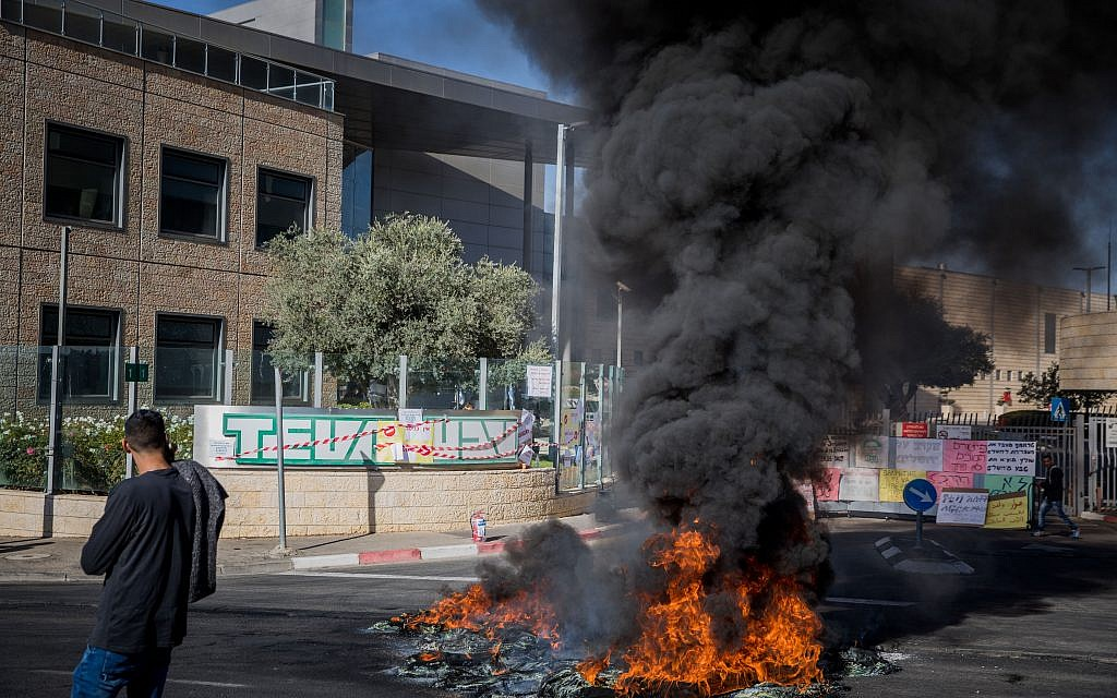 Workers of the Teva company protest against a plan to lay off hundreds of employees, outside the TEVA Pharmaceutical Industries building in Jerusalem, December 17, 2017. (Noam Revkin Fenton/Flash90)