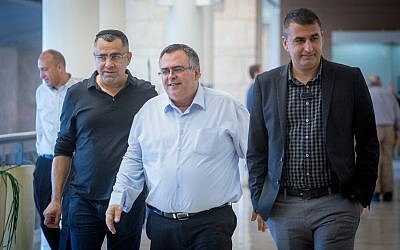 MK David Bitan, center, arrives at a Likud party faction meeting at the Knesset on December 25, 2017. (Miriam Alster/Flash90)