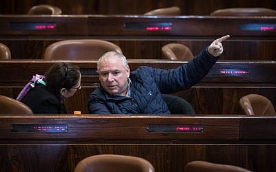 Coalition chairman David Amsalem seen during a marathon plenary session in the Knesset regarding the police recommendations bill, December 27, 2017 (Hadas Parush/Flash90)