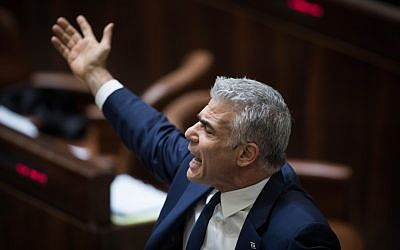 "Knesset Member Yair Lapid reacts during a marathon plenary session in the Knesset regarding the ""Recommendations Bill"" on December 27, 2017. (Hadas Parush/Flash90)"
