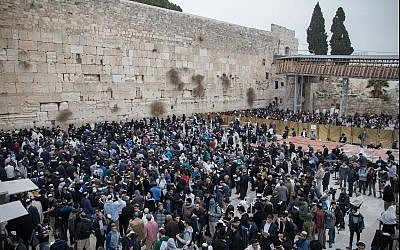 Illustrative: Jews gather at the Western Wall in Jerusalem's Old City to pray for rain, on December 28, 2017. (Flash90)