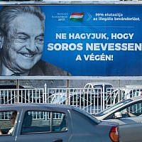 This poster featuring U.S. billionaire George Soros in Szekesfehervar, Hungary, was part of a government campaign, July 6, 2017. (Attila Kisbenedek/ AFP/Getty Images)